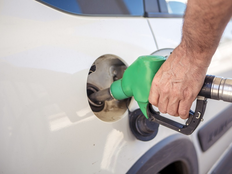 Person filling the car with fuel