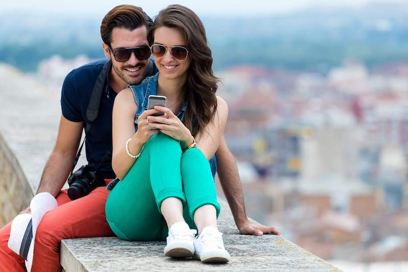 Couple using cell phone in Mexico