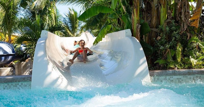 Children on a toboggan in Cancun