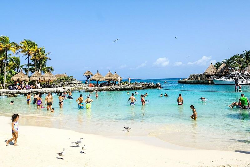 Tourists enjoying Cancun beach